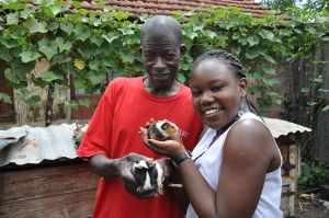 Francis shows Patricia how he harvests guinea pigs for meat - yum!