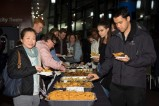 Food was served after the panel discussion, and conversations continued