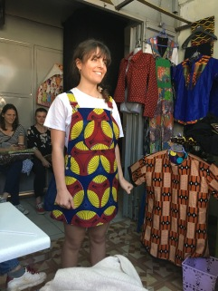 My friend, Pauline, trying on her costumized outfit made out of a Kitenge